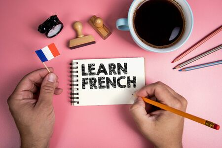 Learn French. Handwriitng text in the notebook. 스톡 콘텐츠