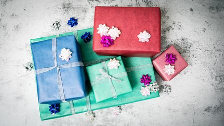 Christmas present boxes on a light marble background. Stock Photo