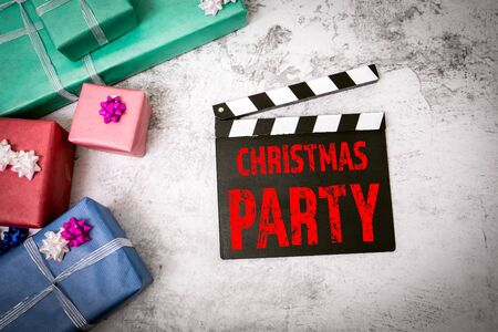 Christmas Party. Movie clapper on the table. Gift boxes, preparation for the celebration