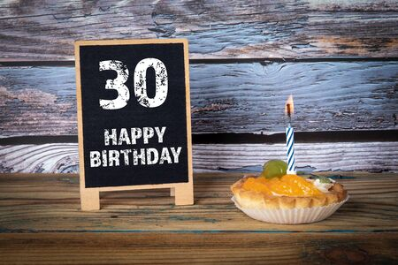 30 Happy Birthday. Cake with candle and greeting card Фото со стока