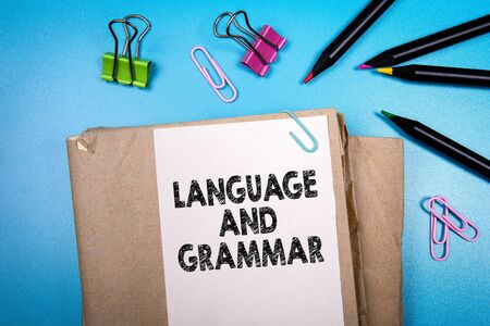 Language and grammar. Books and stationery on the office desk