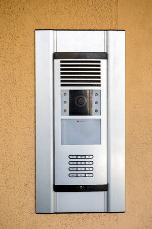 Modern apartment house call button and entrance control panel. With security password and surveillance camera