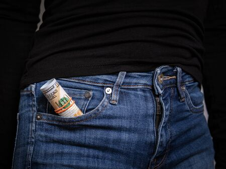 Money in the jeans pocket. Finance and savings concept
