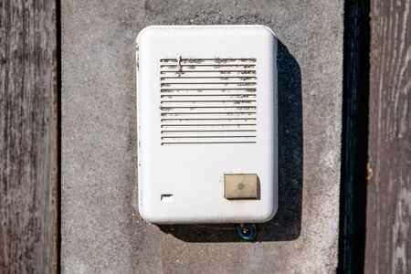 Private house call button. Electronic with loudspeaker, old and dirty