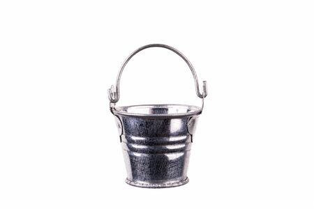 Empty metal bucket isolated on a white background.