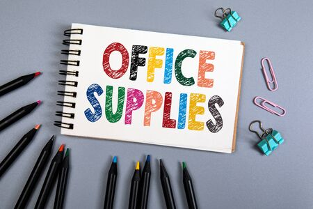 Office Supplies. Handwriitng text in the notebook