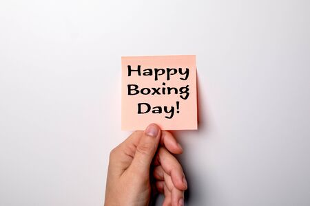 Happy Boxing Day. Sticky note on a background Фото со стока