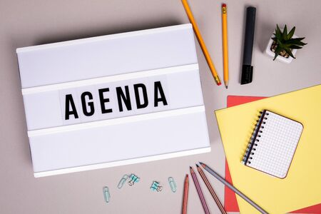 Agenda, workplace, meeting and conference concept. White Lightbox