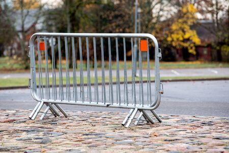 Barrier, metal fence for security for holding off people and transport Stok Fotoğraf