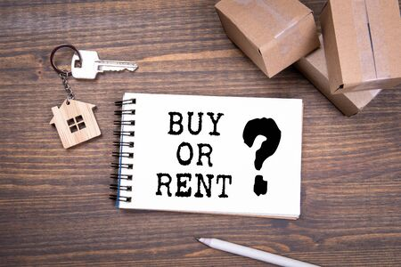 Buy or Rent. Moving, credit and investing Stok Fotoğraf