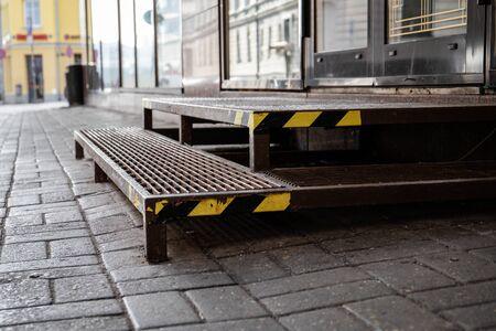 Warning tape on metal stairs outdoors by sidewalk Reklamní fotografie