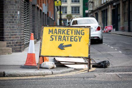 Marketing Strategy Concept. Yellow diversion road sign Banco de Imagens