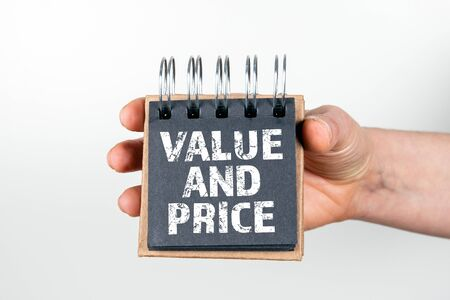 Value and Price. Cost, bill, planning and business concept. Note book in hand on white background