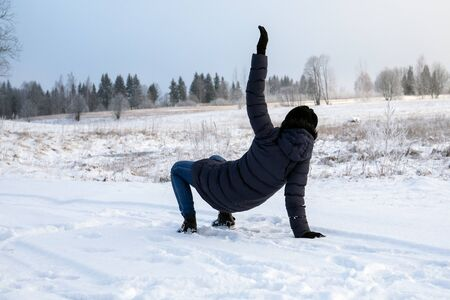 Falling on slippery road. Winter traumas and injuries