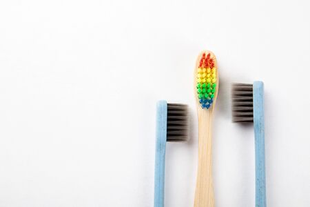 Three toothbrushes on a white background. Relationships, choices, sexual health and equality concept