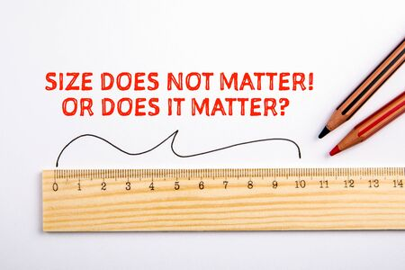 SIZE. Size, unit of measurement, distance and sexual health concept. Wooden liner Stock Photo