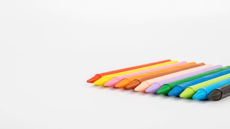 Colored pastel crayons on a white background. creativity, learning