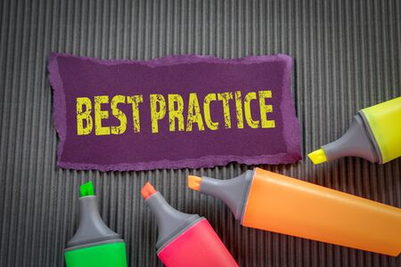BEST PRACTICE. Business concept. Text on torn, colored paper