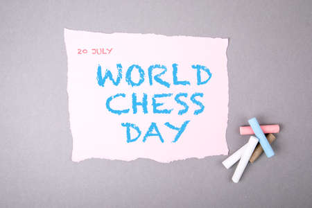 20 JULY WORLD CHESS DAY. Text on note sheet. Colored crayons Stock Photo