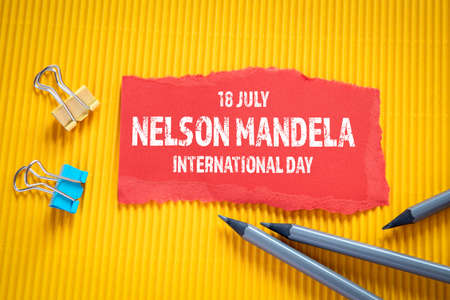 Nelson Mandela International Day 18 July. Text on torn, red paper