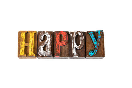 HAPPY. Feelings, stress, psychology and satisfaction concept. Colored wooden letters