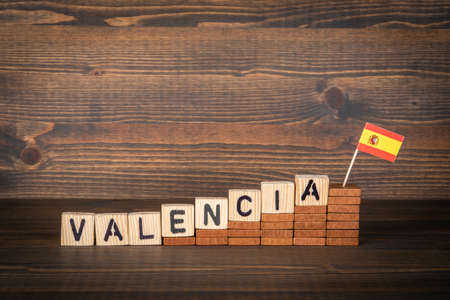 VALENCIA. City in Spain. Steps and flag on a wooden background