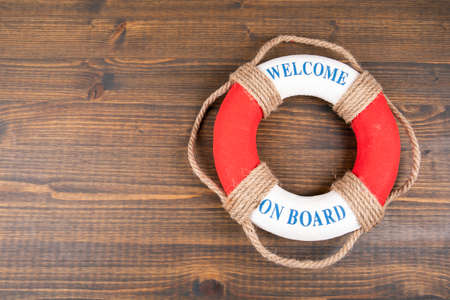 WELCOME ON BOARD. Career, education and teamwork concept. Lifebuoy with text