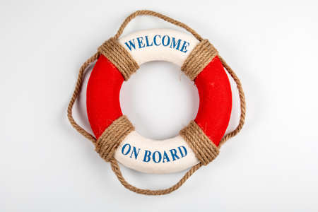 WELCOME ON BOARD. Lifebuoy with text on white background Standard-Bild