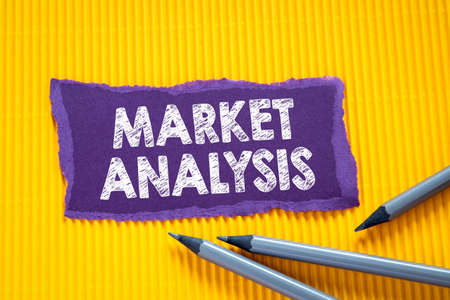 MARKET ANALYSIS concept. Text on torn, colored paper on corrugated background