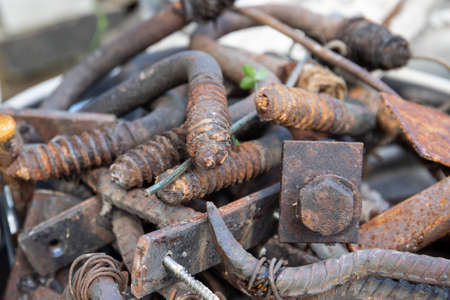 Scrap metal stack. fittings, screws, parts and wires. Waste sorting and care for the environment