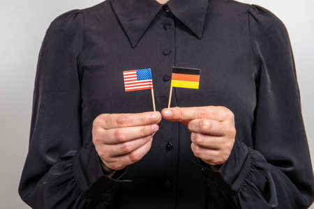 USA and German flags. Economic and political relations. Import export and trade