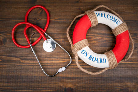 WELCOME ON BOARD. Lifebuoy with text and doctors stethoscope