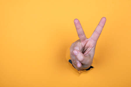 Womans hand is show two fingers up. Finger symbols of peace strength fight, victory symbol