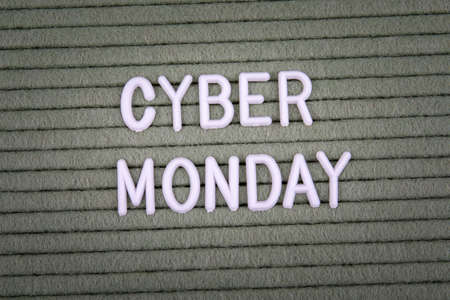 CYBER MONDAY. White letters of the alphabet on a green background.