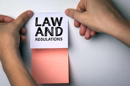 LAW and REGULATIONS concept. Colored sticky notes