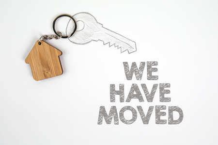 We have moved. Buying and renting, new jobs and opportunities concept. White paper Stock Photo