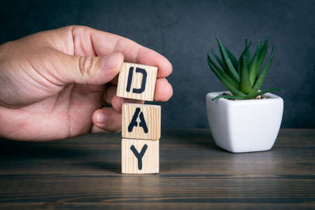 DAY. Text from wooden alphabet letters on the table