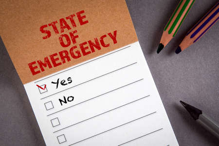 STATE OF EMERGENCY concept. To do list. Notepad with pencils