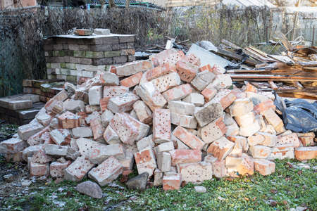 Construction debris, reconstruction works. Waste collection and recycling. Brick stack Stock Photo
