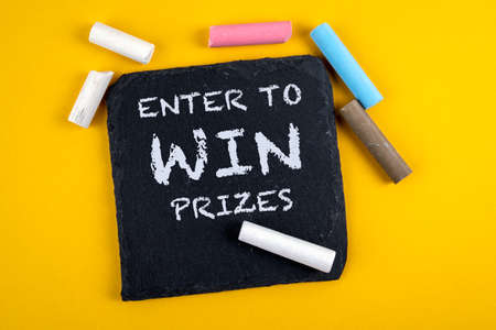 Enter to win prizes. Text on a stone surface. Banner for business