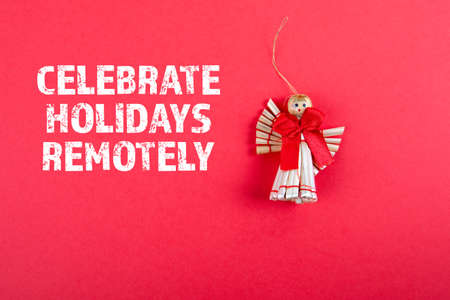 Celebrate Holidays Remotely. Christmas decoration on a red background