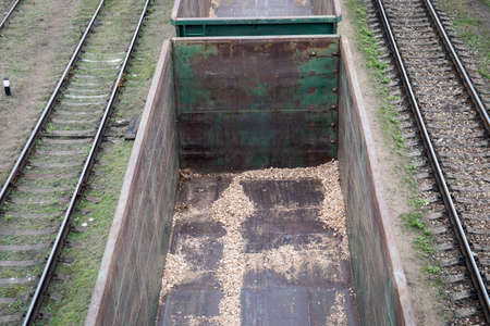 Empty railway wagon. Transportation of bulk cargo. Logistics, import and export