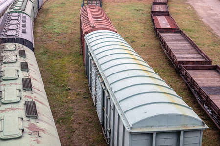 Platform and covered wagons. Several railway tracks. Logistics, import and export