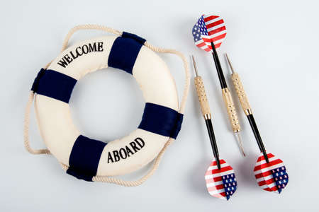 Three darts with the flag of the United States of America and lifebuoy