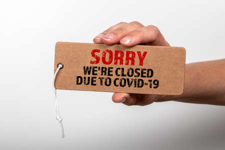 Sorry were CLOSED due to COVID 19. Cardboard price tag Stock Photo
