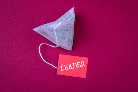 LEADER. Abstract, business, education and success concept. Tea bag