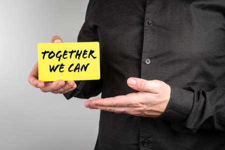 Together We Can. Businessman with a paper card in his hands