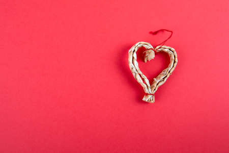 Straw decoration in the shape of a heart. Christmas or valentines day background