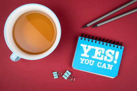 YES YOU CAN. Communication, motivation and recommendation concept. Notebook and cup of tea Stok Fotoğraf