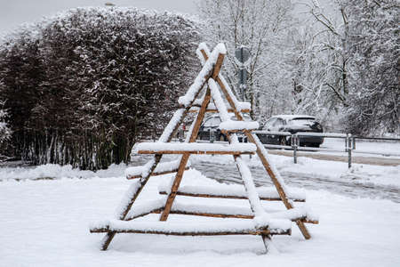 Empty wooden frame for haystack covered with snow in winter. Stok Fotoğraf